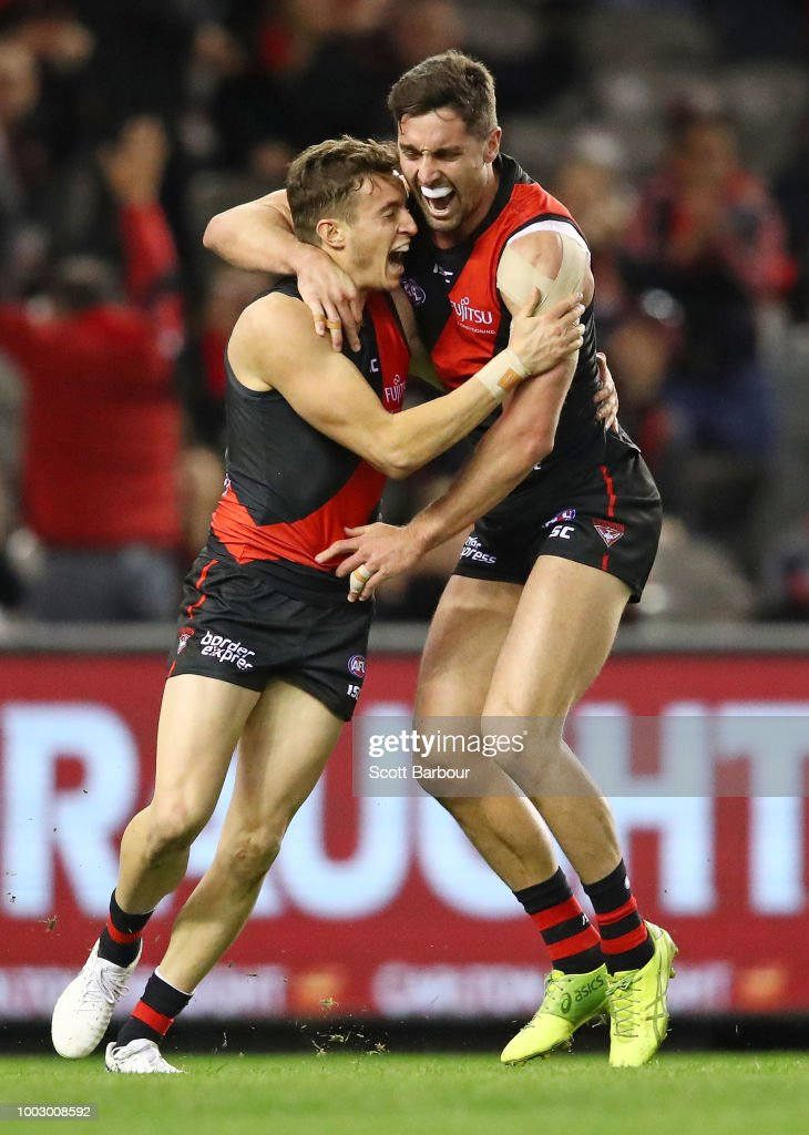 Orazio Fantasia of the Bombers celebrates after kicking a goal with David Myers of the Bombers during the round 18 AFL match between the Essendon Bombers and the Fremantle Dockers at Etihad Stadium on July 21, 2018 in Melbourne, Australia.