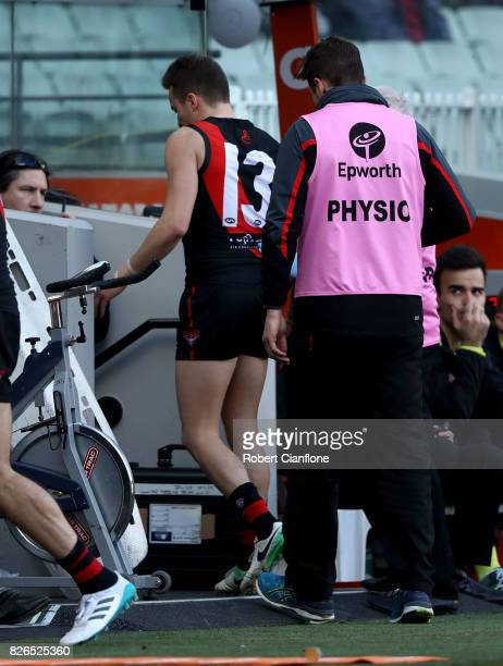 Orazio Fantasia of the Bombers comes off with an injury during the round 20 AFL match between the Essendon Bombers and the Carlton Blues at Melbourne...