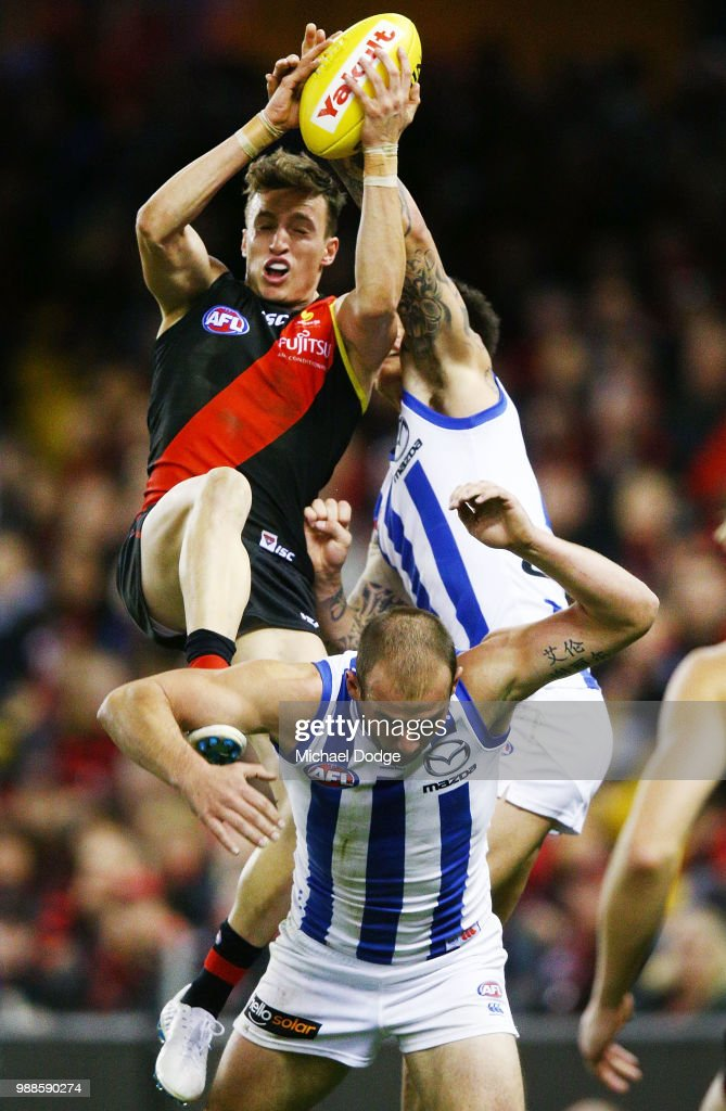 Orazio Fantasia of the Bombers competes for the ball over Ben Cunnington of the Kangaroos during the round 15 AFL match between the Essendon Bombers and the North Melbourne Kangaroos at Etihad Stadium on July 1, 2018 in Melbourne, Australia.