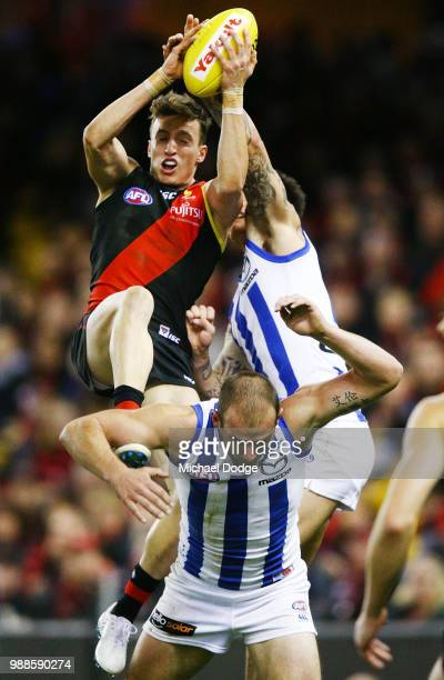 Orazio Fantasia of the Bombers competes for the ball over Ben Cunnington of the Kangaroos during the round 15 AFL match between the Essendon Bombers...