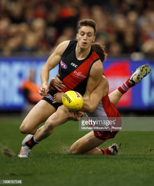 Orazio Fantasia of the Bombers is tackled by Nick Smith of the Swans during the 2018 AFL round 19 match between the Essendon Bombers and the Sydney...