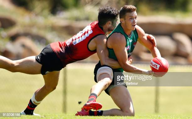 Orazio Fantasia of the Bombers is tackledby Ben McNiece of the Bombers during the Essendon Bombers AFL training session at The Hangar on February 2...