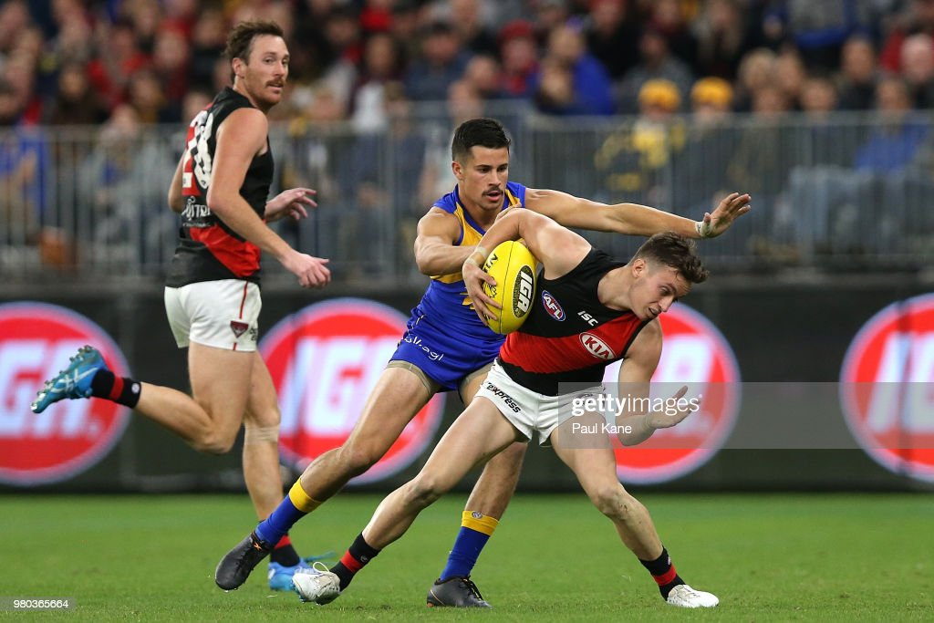 Orazio Fantasia of the Bombers Looks to break from Liam Duggan of the Eagles during the round 14 AFL match between the West Coast Eagles and the Essendon Bombers at Optus Stadium on June 21, 2018 in Perth, Australia.