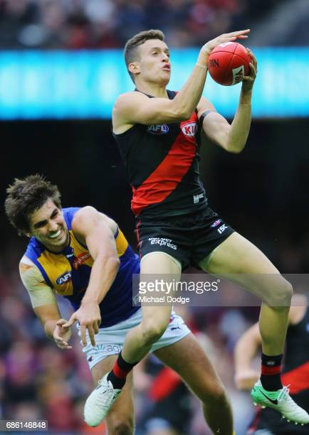 Orazio Fantasia of the Bombers marks the ball against Andrew Gaff of the Eagles during the round nine AFL match between the Essendon Bombers and the...