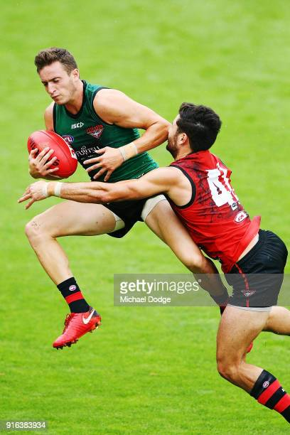 Orazio Fantasia of the Bombers marks the ball against Ben McNeice of the Bombers during the Essendon Bombers AFL IntraClub Match at The Hangar on...