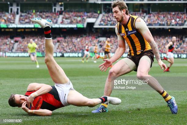 Orazio Fantasia of the Bombers marks the ball against Kaiden Brand of the Hawks during the round 20 AFL match between the Hawthorn Hawks and the...