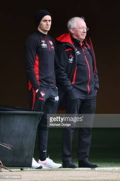 Orazio Fantasia of the Bombers on the sidelines with club doctor Bruce Reid during an Essendon Bombers AFL training session at The Hangar on July 16,...