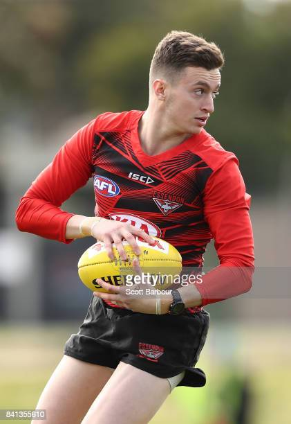 Orazio Fantasia of the Bombers runs with the ball during an Essendon Bombers AFL training session at the Essendon Football Club on September 1 2017...