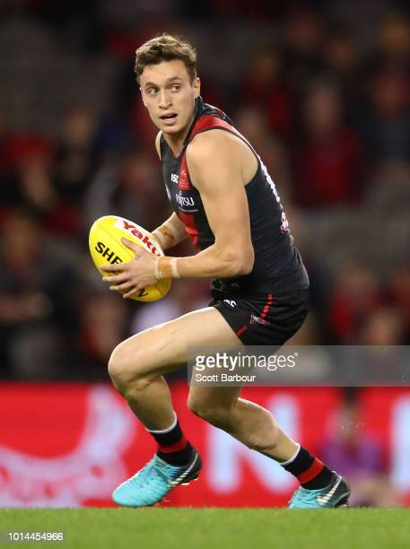 Orazio Fantasia of the Bombers runs with the ball during the round 21 AFL match between the Essendon Bombers and the St Kilda Saints at Etihad...