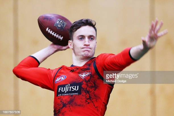 Orazio Fantasia of the Bombers throws a Gridiron ball during an Essendon Bombers AFL training session at The Hangar on July 30 2018 in Melbourne...