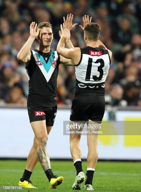 Orazio Fantasia of the Power celebrates his goal with the incoming Kane Farrell during the 2021 AFL Round 08 match between the Port Adelaide Power...