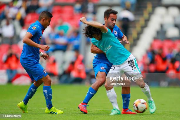 Orbelin Pineda and Adrian Aldrete of Cruz Azul fight for the ball with Matias Britos of Queretaro during the 13th round match between Cruz Azul and...