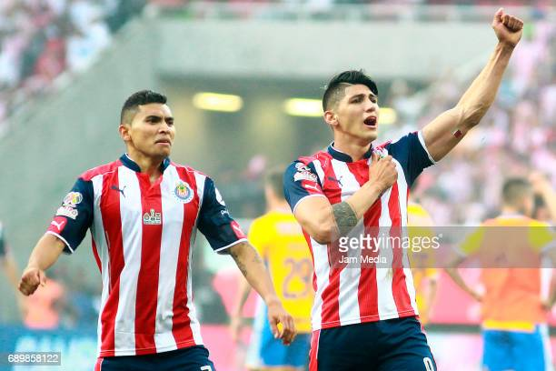 Orbelin Pineda and Alan Pulido of Chivas celebrate the championship after winning the Final second leg match between Chivas and Tigres UANL as part...