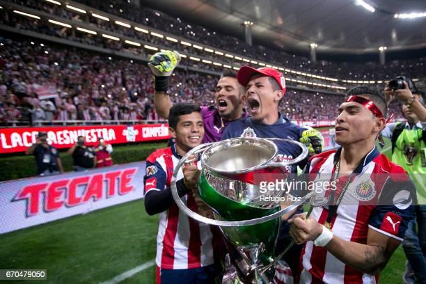 Orbelin Pineda Angel Zaldivar Miguel Jimenez and Michelle Benitez of Chivas celebrate with the trophy after winning the final match between Chivas...