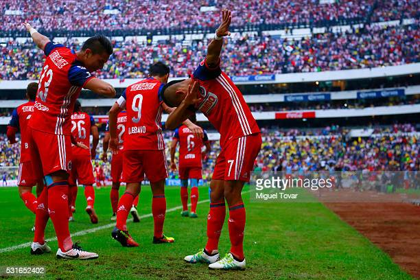 Orbelin Pineda of Chivas celebrates with teammates after scoring during the quarter finals second leg match between America and Chivas as part of the...