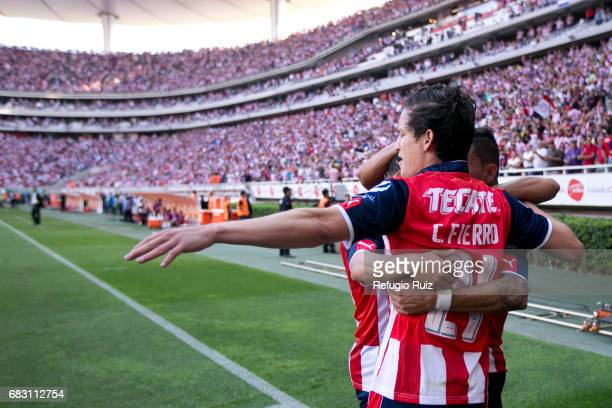 Orbelin Pineda of Chivas celebrates with teammates after scoring the first goal of his team during the quarter finals second leg match between Chivas...