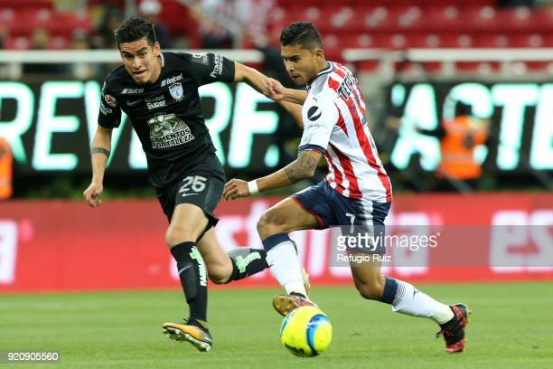 Orbelin Pineda of Chivas fights for the ball with Alexis Peña of Pachuca during the 8th round match between Chivas and Pachuca as part of the Torneo...