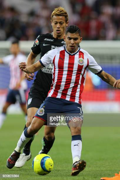 Orbelin Pineda of Chivas fights for the ball with Keisuke Honda of Pachuca during on the 8th round match between Chivas and Pachuca as part of the...