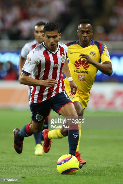 Orbelin Pineda of Chivas fights for the ball with Renato Ibarra of America during the 10th round match between Chivas and America as part of the...
