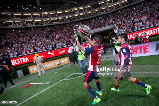 Orbelin Pineda of Chivas lifts the trophy after winning the final match between Chivas and Morelia as part of the Copa MX Clausura 2017 at Chivas...