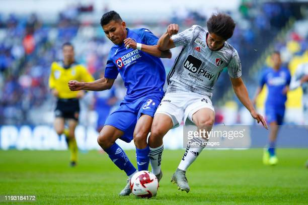 Orbelin Pineda of Cruz Azul and Jose Abella of Atlas struggle for the ball during the 1st round match between Cruz Azul and Atlas as part of the...