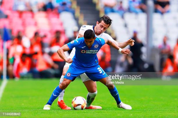 Orbelin Pineda of Cruz Azul fights for the ball with Alan Mozo of Pumas during the 15th round match between Cruz Azul and Pumas UNAM as part of the...