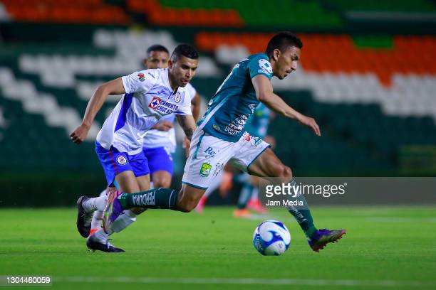 Orbelin Pineda of Cruz Azul fights for the ball with Angel Mena of Leon during the 8th round match between Leon and Cruz Azul as part of the Torneo...