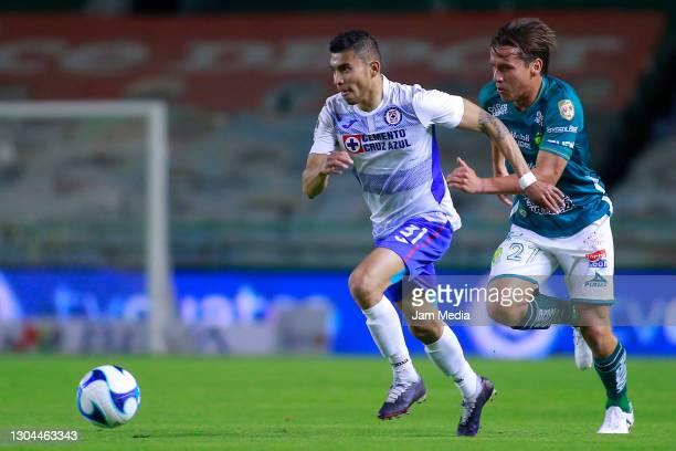Orbelin Pineda of Cruz Azul fights for the ball with Fernando Gonzalez of Leon during the 8th round match between Leon and Cruz Azul as part of the...
