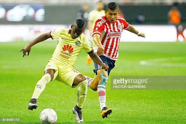 Orbelin Pineda of Guadalajara vies for the ball with Darwin Quintero of America at Chivas' stadium on March 13 2016 in Guadalajara Mexico AFP...
