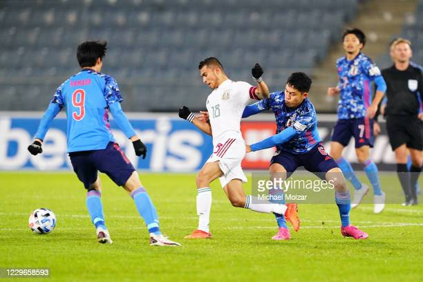 Orbelin Pineda of Mexico and Wataru Endo of Japan fight for the ball during the international friendly match between Japan and Mexico at Merkur Arena...