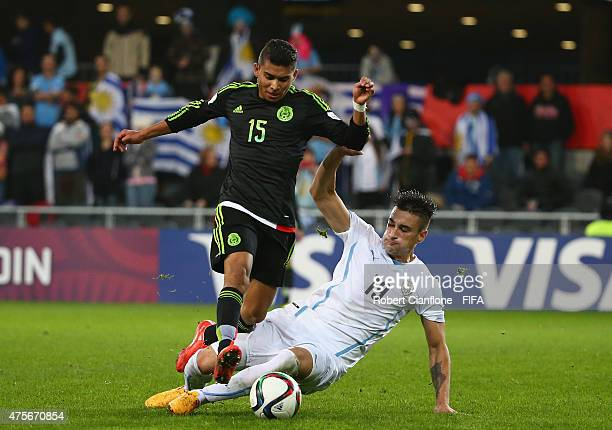 Orbelin Pineda of Mexico is challenged by Erick Cabaco of Uruguay during the FIFA U20 World Cup New Zealand 2015 Group D match between Mexico and...