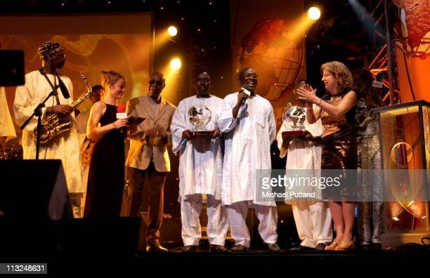 Orchestra Baobab receive an award from Papa Wemba Radio 3 World Music Awards Concert Ocean Hackney London 24 March 2003