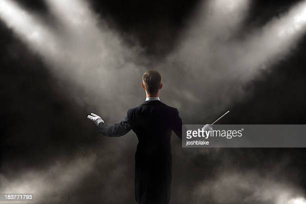 orchestra conductor - maestro stock photos and pictures