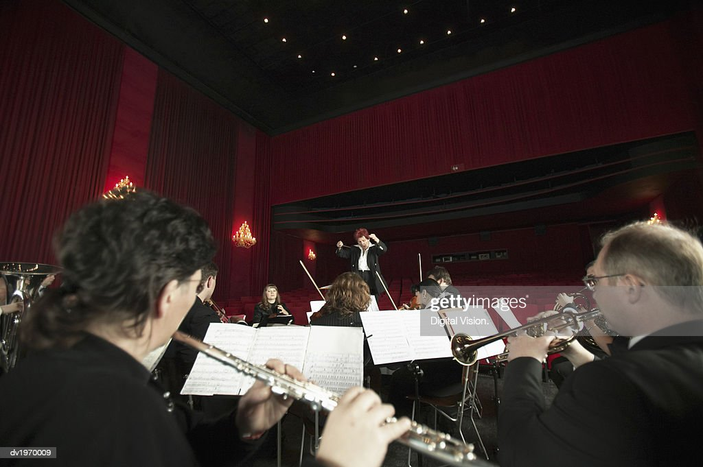 Orchestra Performing in a Theatre : Stock Photo