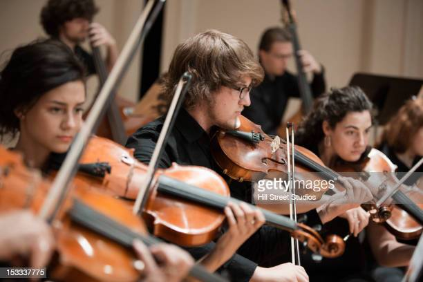 Orchestra playing violins