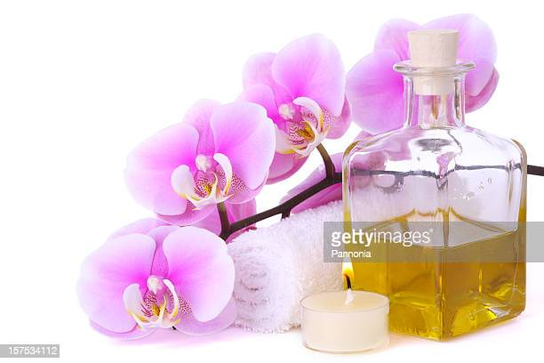 orchid with towel, candle and massage oil - massage oil stock pictures, royalty-free photos & images
