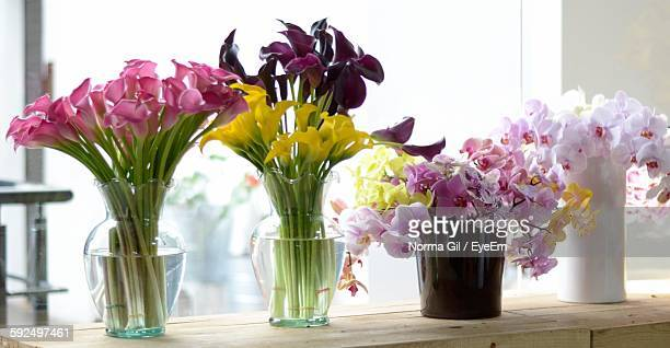 Orchids In Vase On Table