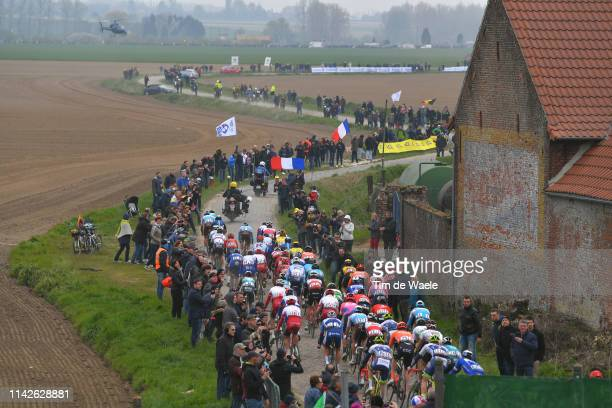 Orchies / Landscape / Peloton / Cobblestones / Fans / during the 117th Paris-Roubaix a 257km race from Compiègne to Roubaix / @Paris_Roubaix /...