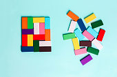 order and chaos. Chaotic unorganized colored dominoes and ordered.