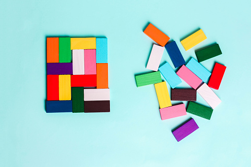 order and chaos. Chaotic unorganized colored dominoes and ordered. 1156397669