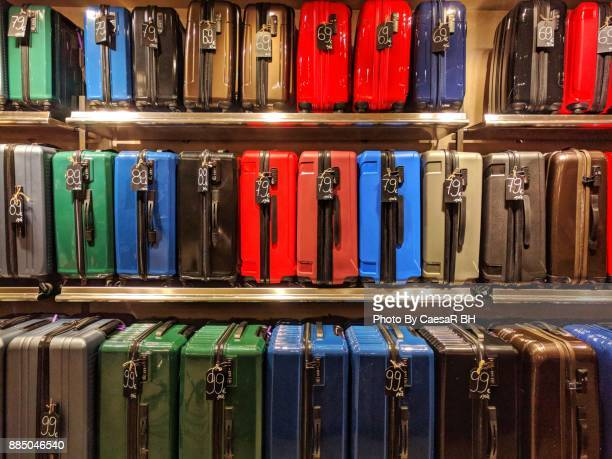 order luggage. shelving luggage. - luggage rack stock photos and pictures