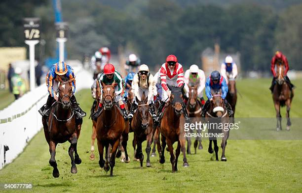 Order of St George ridden by jockey Ryan Moore rides across the finish line to win the Gold Cup in Honour of The Queen's 90th Birthday during Ladies'...