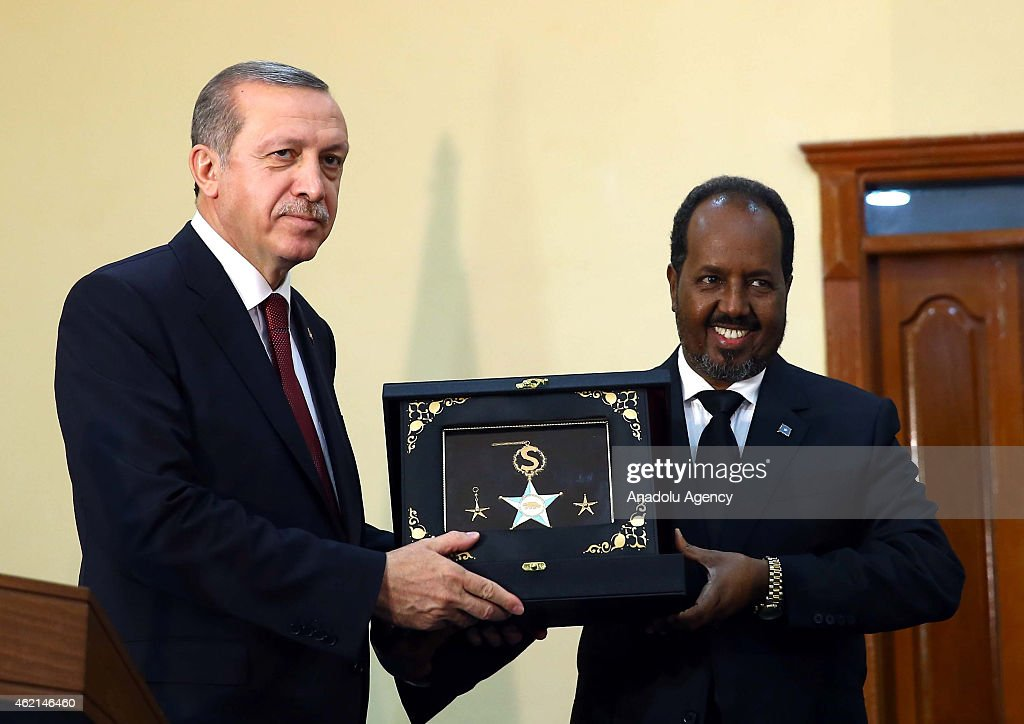 Order of State of Somalia is presented to Turkish President Recep Tayyip Erdogan (L) by Somalian President Hassan Sheikh Mohamoud (R) after a press conference in Mogadishu, Somalia on January 25, 2015.