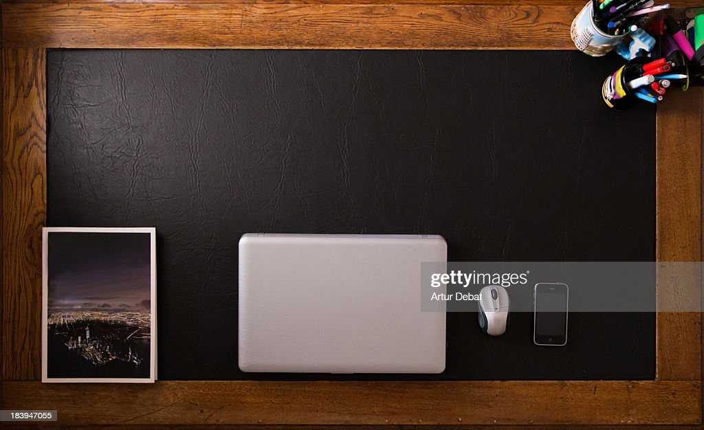Ordered desk view from above with arranged objects : Stock Photo