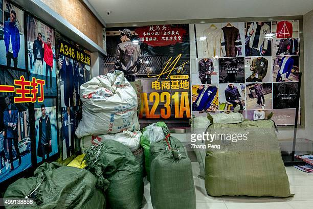Ordered goods are packed and piled at a corner waiting to be delivered to customers by logisticsAn ecommerce base in Hangzhou where wholesalers...