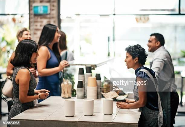 Ordering cup of Arabic coffee in modern restaurant
