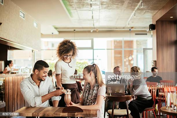 ordering drinks - paying stock photos and pictures
