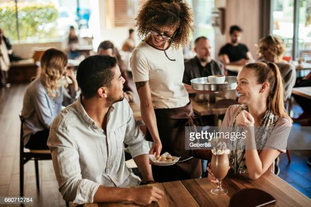 ordering drinks - waiter stock pictures, royalty-free photos & images