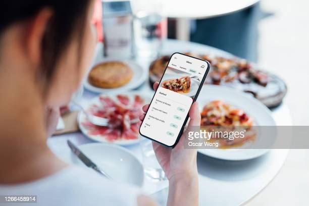 ordering food at restaurant with contactless menu on smart phone - catering building stock pictures, royalty-free photos & images