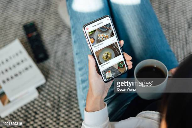 ordering food online at home with smartphone - convenience stock pictures, royalty-free photos & images